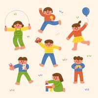 Set di simpatici bambini che giocano sul prato vettore