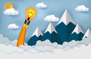 lampadina che si lancia nel cielo attraverso nuvole e montagna