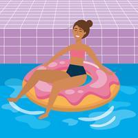 Donna che si siede nel galleggiante dello stagno della ciambella vettore