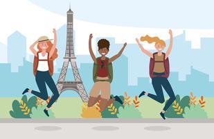 Gruppo di amici femminili che saltano davanti alla torre Eiffel