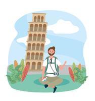 Turista maschio che si siede davanti alla torre pendente di Pisa
