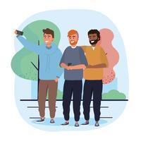 Gruppo di amici maschii che prendono selfie fuori