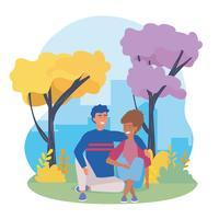 Uomo e donna che si siedono nel parco