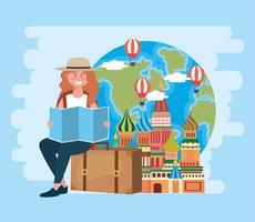 Donna che si siede sui bagagli con il quadrato rosso e la mappa di mondo