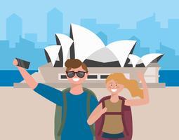 Giovani coppie che prendono selfie davanti al teatro dell'opera di Sydney