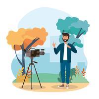Reporter maschio davanti alla macchina fotografica in parco vettore