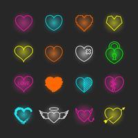 set di icone al neon del cuore vettore