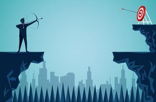 uomo d'affari in piedi su una scogliera sparando una freccia attraverso la scogliera verso il bersaglio vettore