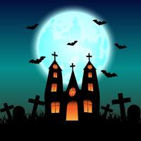 Casa stregata di Halloween con la luna blu incandescente
