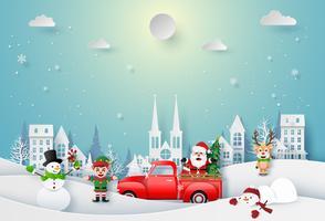 Arte di carta origami di Babbo Natale e personaggio di Natale che celebra in città