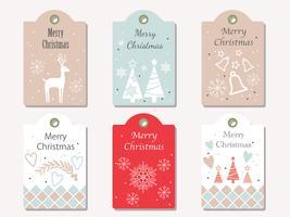 Le etichette del regalo di vettore di Natale hanno messo isolato su un fondo normale.