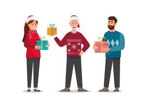 Famiglia che tiene i regali di Natale vettore