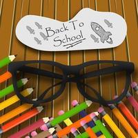 Realistico messaggio di ritorno a scuola con occhiali e matite