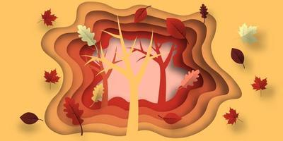 Carta tagliata in autunno con disegni di foglie e alberi