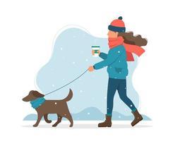 Donna che cammina un cane in inverno