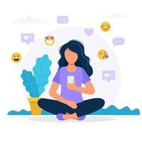 Donna con uno smartphone, icone social media vettore