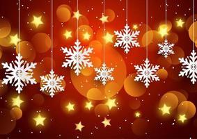 fiocchi di neve appesi e luci sfocate vettore