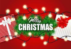 Il Natale progetta con le luci dell'albero di Natale e i contenitori di regalo su rosso