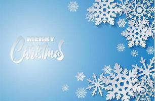 Disegno di buon Natale con fiocchi di neve bianchi stile carta arte blu