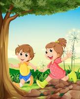 Due bambini adorabili che giocano sotto l'albero vettore