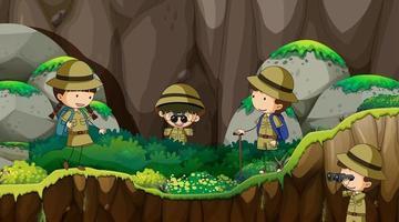 bambini scout che esplorano la natura vettore