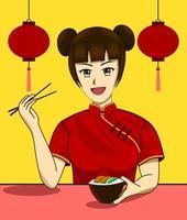 Le donne cinesi mangiano cibo vegetariano durante il Festival Vegetariano