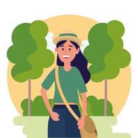 donna universitaria che indossa cappello e alberi con cespugli