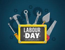strumenti di costruzione con emblema per la festa del lavoro