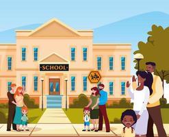 facciata della scuola con genitori e figli