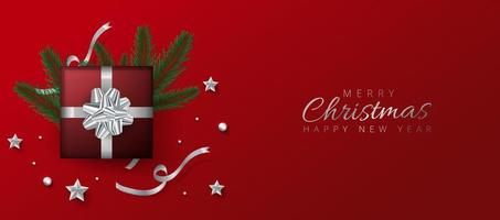 Intestazione rossa o banner design decorato con scatola regalo, palline e foglie di pino vettore