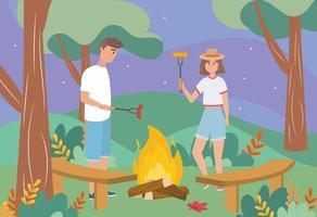 uomo e donna nel fuoco di legna con salsiccia e pannocchia vettore