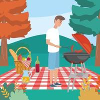 uomo con grigliate e salsicce nella tovaglia con il cibo