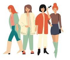 Quattro giovani donne in abiti autunnali in piedi e camminando vettore