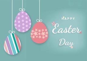 appendere le uova di Pasqua su sfondo blu con il testo