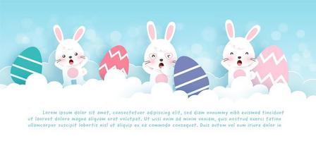 banner del giorno di Pasqua con simpatici conigli in giardino