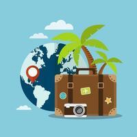 valigia di fronte al globo e alberi