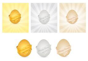 Vettori di uova di Pasqua d'oro, argento e bronzo