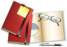quaderni e occhiali da lettura sullo sfondo