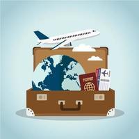 valigia con articoli da viaggio vettore