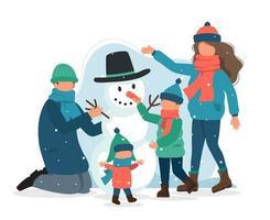famiglia che fa un pupazzo di neve in inverno vettore