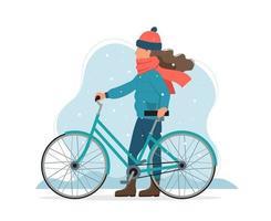 ragazza che tiene la bici in inverno vettore