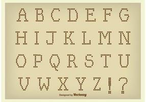 Alfabeto in stile punto croce vettoriale