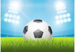 Pallone da calcio brillante nel vettore dello stadio