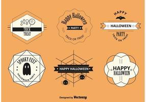 Etichette e distintivi di Halloween vettore