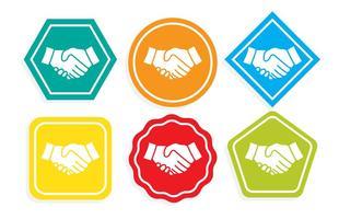 Icone colorate della stretta di mano vettore
