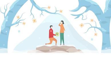 uomo che propone alla donna sulla roccia tra gli alberi