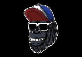 testa di gorilla indossando occhiali da sole illustrazione vettore