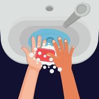 lavaggio a mano con sapone nel lavandino