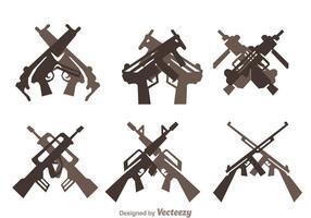 Set di icone di pistole incrociate vettore