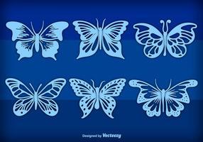 Farfalle disegnate a mano blu vettore